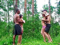 Two couples in a forest