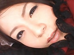Rina Koizumi smiles for the camera as he cums on her face