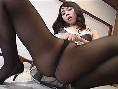 Yuka Osawa Asian on high heels arouses her twat with black thong