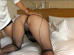 Ruka Ichinose Asian in fishnet stockings sits with ass up in air