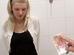 Young teen chick gets fuck for money in a public restroom