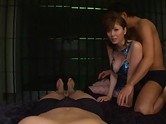 Yuma Asami Asian in shiny blue blouse in behind the bars hot orgy