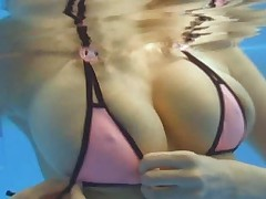 Yuma Asami sexy cleavage in a very tiny pink bikini