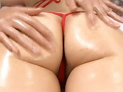 Saki Tsuji Asian with red thong in ass is massaged with oil