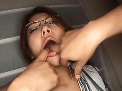 Aya Matsuki Asian has two fingers stuck in her salivating mouth
