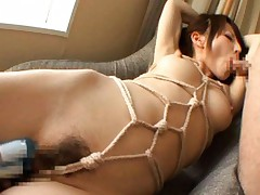 Hana Masaki Asian in ropes gets dick in mouth and vibrator