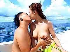 Slutty Japanese model shows off and gets a hard fucking on the yacht