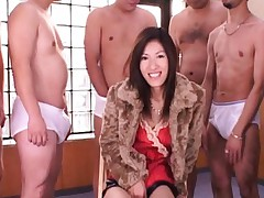 Rei Shina in red lingerie surrounded by erect dicks rubs pussy