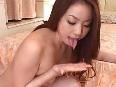 Risa Kasumi Asian sucks cock and pours sperm from it in her palm