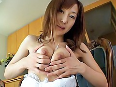 Pretty Asian tramp enjoys showing off her nice big fun bags of joy