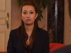 Nao Yoshizaki Asian turns two studs on with her sober office suit