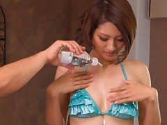 Rina Fujimoto Asian gets body oil over her hot blue lingerie