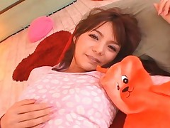 Tina Yuzuki is cute and she knows it. She starts to strip her sexy clothes off