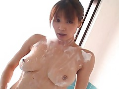 Ai Kurosawa lathers up her breasts and pussy in the bathtub