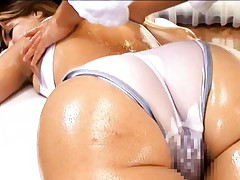 Maria Ozawa Asian is massaged with lotion over her nylon body