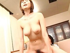 Yuma Asami Asian with generous boobies rides phallus on the floor