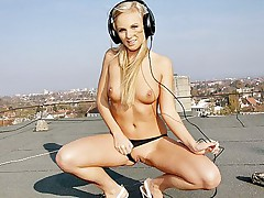 Blonde chick strips naked on the roof