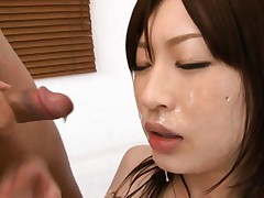 Riko Oshima Asian with juicy melons takes sperm right on face