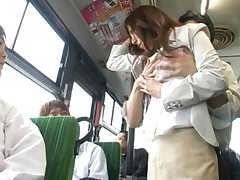Honami Takasaka has pussy in nylon touched with magazine in bus