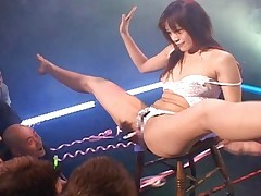 Mika Mizuno performs a slow and sexy strip tease for her fans
