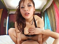 Koisaya Asian looks at the guy face while she rides his joystick
