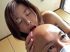 Lovely Asian babe and her bald date are having a good time while he eats her out