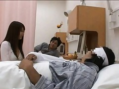Japanese AV Model watches patient stroking his dick next to her