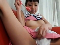 Kurara Asian cheerleader teases her pussy and jugs with vibration