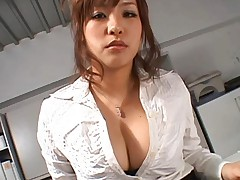 Japanese AV Model with big cleavage exams guy before screwing him