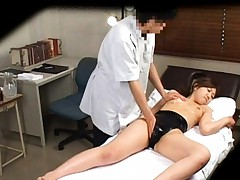 Japanese AV Model has twat rubbed with oil and gets vibrator on