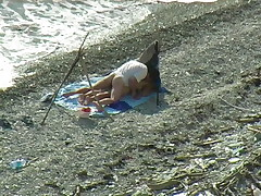 A flopping couple on a beach spy camera