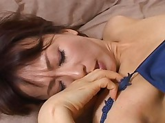 Reiko Makihara gets laid on the bed by a horny asian dude with a giant dick