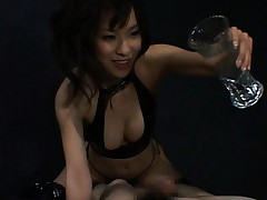 Kaho Kasumi plays with her slave boys cock in this video