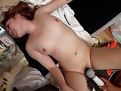 Horny Japanese chick and her date have a big pussy toy that they are using