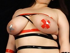 Chiharu Mizushima with huge boobs in tapes and strips opens legs