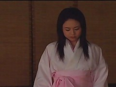 Unknown Model removes her silk kimono for her samurai husband