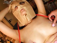 An Mashiro Asian with paper bag on head has sex toys teasing her