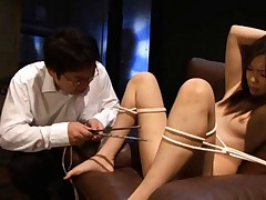 Asuka Sawamoto with tied legs and hands is fucked with sticks