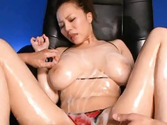 Ruri Saijoh Asian with lotion on pussy gets vibrators on hooters