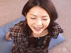 Rina Koizumi sucks a hard cock until it shoots cum on her face