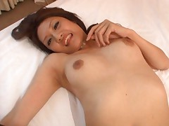 Rina Fujimoto Asian in black stockings and with fine tits strokes