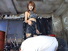 Naughty Asian mistress uses her cord to spank her bad boy slaves