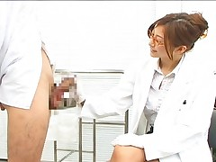 Chihiro Hara in a nurse uniform and stroking his huge erection
