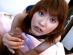 Japanese teen slut has a great amount of fun jerking off her date and smiles