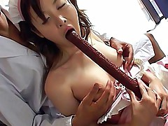 Sexy Asian model with nice tits and ass gets a pussy pounding with odd dildo