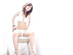 Erika Asian whore takes her lingerie off sitting on the toilet