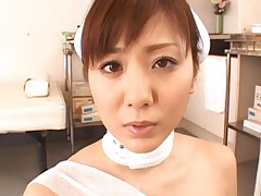 Yuma Asami Asian with bandages over her boobs giving blowjob