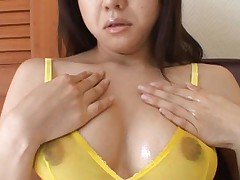 Chihiro Kawaoka puts oil on toes and over assets in yellow bra