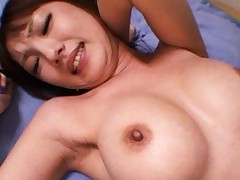 Tsubasa Amami Asian doll with big tits shows hairy pussy to poke