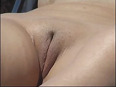 Silicone beach tits and bald twat caught